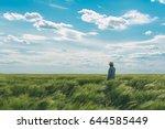Farmer Walking Through A Green...