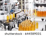 bottles filled with yellow... | Shutterstock . vector #644589031