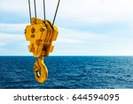 crane hook in the sea with sky... | Shutterstock . vector #644594095