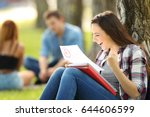 excited student checking an... | Shutterstock . vector #644606599