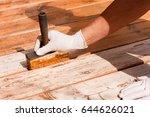 painter staining deck boards... | Shutterstock . vector #644626021