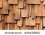 Small photo of Abstract background of unregular texture pattern of overlapping Western Red Cedar shingles natural organic wooden wall siding for residential buildings