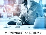 woman using laptop at workplace ... | Shutterstock . vector #644648059