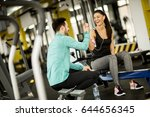 young woman exercise in a gym... | Shutterstock . vector #644656345