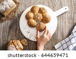 female hand breaking freshly... | Shutterstock . vector #644659471