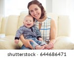happy mother holding her cute... | Shutterstock . vector #644686471