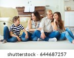 portrait of young happy family... | Shutterstock . vector #644687257