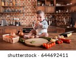 Little Boy Sitting On Kitchen...