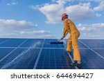 labor working on cleaning solar ... | Shutterstock . vector #644694427