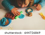 child playing with clay molding ... | Shutterstock . vector #644726869
