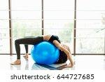 girl do exersice with ball on...   Shutterstock . vector #644727685