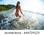 happy woman runs into ocean... | Shutterstock . vector #644729125