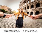 young couple at the colosseum ... | Shutterstock . vector #644754661