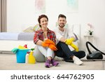 happy young couple cleaning... | Shutterstock . vector #644762905