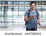 handsome asian man traveler... | Shutterstock . vector #644788441