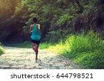 female athlete running on... | Shutterstock . vector #644798521