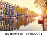 Stock photo channel in amsterdam netherlands houses river amstel landmark old european city spring landscape 644800771