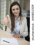 Small photo of Business woman shows thumb up, empty fraudulent contract