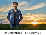 teenage boy standing in a wheat ... | Shutterstock . vector #644809417