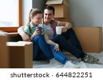 couple moving in house sitting... | Shutterstock . vector #644822251
