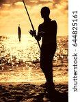 Fishermen On The Beach. Sunris...
