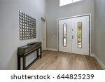 white front door opens to a... | Shutterstock . vector #644825239