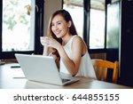 beautiful asia woman using... | Shutterstock . vector #644855155