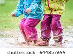 children in rubber boots and... | Shutterstock . vector #644857699