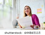 smiling woman working at office ... | Shutterstock . vector #644865115