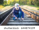 a small pre school boy plays on ... | Shutterstock . vector #644874109