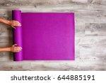 woman rolling her yoga mat... | Shutterstock . vector #644885191