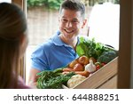 man making home delivery of... | Shutterstock . vector #644888251