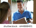 courier delivering package to... | Shutterstock . vector #644888401