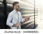 handsome young businessman... | Shutterstock . vector #644888881