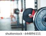 metal heavy barbell in holder... | Shutterstock . vector #644896111