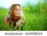blonde lays and blow on... | Shutterstock . vector #644908519