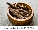 dried licorice sticks in wooden ... | Shutterstock . vector #644932657