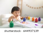 funny laughing asian baby girl... | Shutterstock . vector #644937139