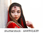 thoughtful indian bride covered ... | Shutterstock . vector #644941639