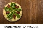 raw pizza with vegetables on... | Shutterstock . vector #644957011