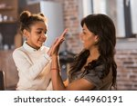 beautiful mother and daughter... | Shutterstock . vector #644960191