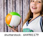 beautiful girl with volleyball.  | Shutterstock . vector #644981179