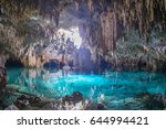 Small photo of Beautiful view of Cenote Sac Actún - Akumal, near Tulum city located in Yucatán Peninsula - Mexico