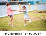 adorable little girl have a lot ... | Shutterstock . vector #645069367