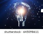 exploding light bulb on a blue... | Shutterstock . vector #645098611