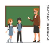 female teacher with pupils. ... | Shutterstock .eps vector #645102487