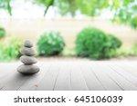 zen stones on wooden in... | Shutterstock . vector #645106039