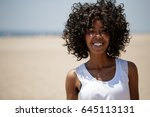 woman on a beach smile happy | Shutterstock . vector #645113131