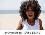 woman on a beach smile happy | Shutterstock . vector #645113149