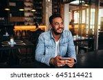 indoor shot of young man... | Shutterstock . vector #645114421